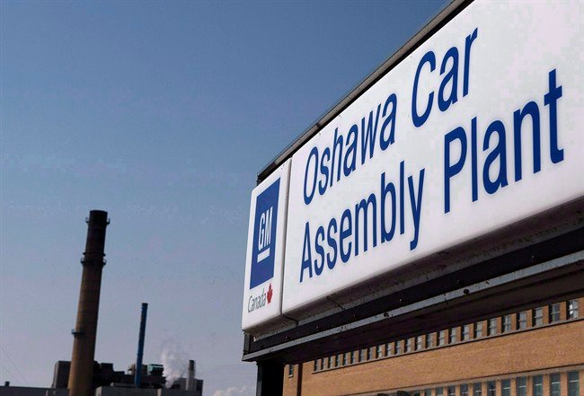 A sign outside Oshawa's General Motors car assembly plant is shown in Oshawa, Ont. (Source: CP)