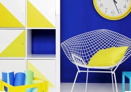 Panyl decals brighten up a white Ikea library.