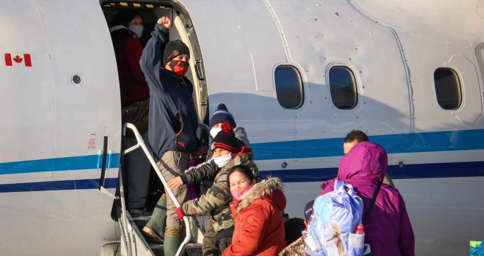 Neskantaga First Nation residents board a plane to return home from Thunder Bay on Dec. 19, 2020, following a two month evacuation that was triggered by problems at their drinking water treatment plant.