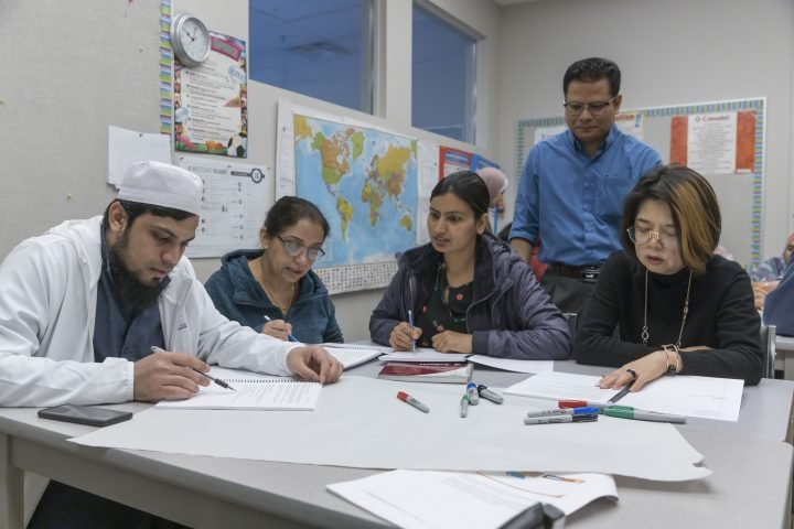 English language classes for immigrants in Surrey, British Columbia. Picture taken before COVID-19 pandemic